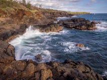 Lava rock off stunning glass beach, Kauai Stock Photography