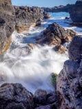 Lava rock off stunning glass beach, Kauai Royalty Free Stock Images