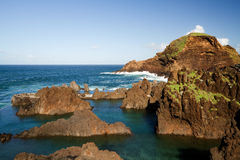 Lava-rock pools on the island of Madeira. Natural swimming-pools in Porto Moniz, Madeira royalty free stock images