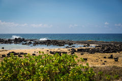Lava Rock and Sand Beach, Kona Hawaii Stock Images