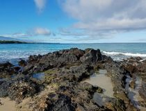 Lava Rock Shoreline and Clouds over the Ocean Royalty Free Stock Photo