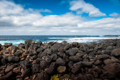 Lava rocks breakwater Stock Image