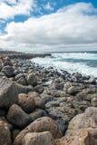 Lava rocks breakwater Stock Photo