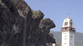 Lava rocks and a church at Candelaria, Tenerife, Spain stock video