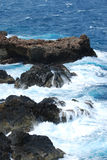 Lava Rocks Jutting in to the Tropical Waters Off of Aruba Royalty Free Stock Images