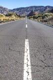 Lava rocks and road to the volcano Teide on Tenerife Stock Photo