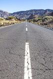 Lava rocks and road to the volcano Teide on Tenerife Stock Image