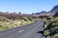 Lava rocks and road to the volcano Teide on Tenerife Royalty Free Stock Photo