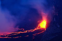Lava and steam in crater of Nyiragongo volcano in Virunga Nation. Al Park in Democratic Republic of Congo, Africa. Picture taken during dusk with blue coloured royalty free stock images