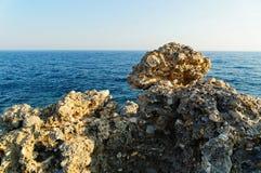 Lava stone in front of blue Mediterranean sea on the shoreline of Alanya city. Antalya, Turkey. Lava stone in front of blue Mediterranean sea on the shoreline stock photography