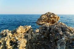 Lava stone in front of blue Mediterranean sea on the shoreline of Alanya city. Antalya, Turkey. Lava stone in front of blue Mediterranean sea on the shoreline royalty free stock images