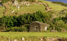 Lava stone house, Azores archipelago (Portugal) Royalty Free Stock Photography