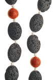 Lava Stone Necklace. Necklace made of all natural beads - lava stone, coral and freshwater pearls Stock Photos