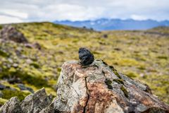 A lava stone standing against the backdrop of Icelandic landscap Stock Image