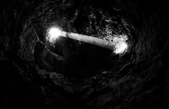 Lava Tube in Mojave National Preserve. A lava tube is a natural conduit formed by flowing lava which moves beneath the hardened surface of a lava flow Royalty Free Stock Photos