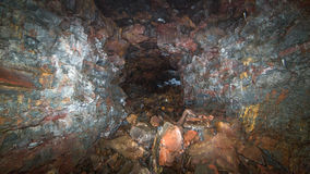 A lava tube tunnel. A large lava tube tunnel in Iceland stock photos