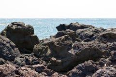 Lava, volcanic lava on beach of Sicily island - beautiful nature stock images