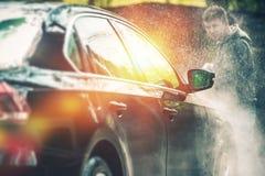 Lavado y limpieza del coche Foto de archivo libre de regalías