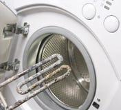 Lavadora y calentador dañado Imagen de archivo libre de regalías