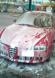 Lavage de voiture mousseux Photos libres de droits