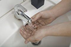 Lavagem das mãos Imagens de Stock