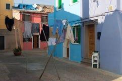 Lavagem de Burano, Veneza fotografia de stock