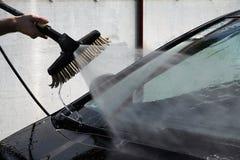 Lavagem de carros da mão Imagens de Stock
