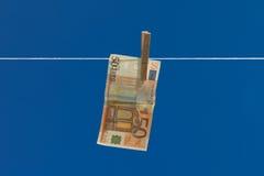Lavagem de dinheiro. Imagens de Stock