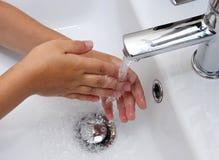 Lavaggio della mano Fotografia Stock