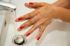 Lavaggio della mano Immagini Stock