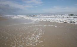 Lavaggio di marea Fotografie Stock