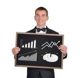 Lavagna con il grafico dei profitti fotografia stock