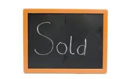 Lavagna con il testo venduto Fotografia Stock