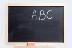 Lavagna con l'alfabeto Immagini Stock