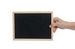 Lavagna della tenuta della mano della donna su fondo bianco Fotografie Stock Libere da Diritti