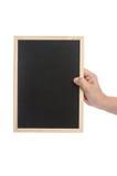 Lavagna della tenuta della mano della donna su fondo bianco Fotografie Stock