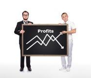 Lavagna della tenuta di due uomini d'affari Fotografie Stock Libere da Diritti