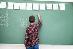 Lavagna di scrittura dello scolaro Fotografia Stock