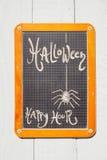 Lavagna, Halloween, ragno e happy hour Immagini Stock Libere da Diritti