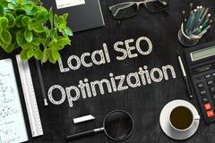 Lavagna nera con il locale SEO Optimization rappresentazione 3d fotografia stock