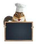 Lavagna vuota del menu della tamia del cuoco unico della tenuta divertente del cuoco Fotografie Stock Libere da Diritti
