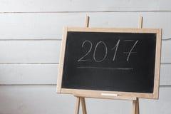 Lavagna vuota di concetto di 2017 nuovi anni, modello per il contenuto Fotografia Stock Libera da Diritti