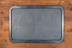 Lavagna vuota sulla tavola di legno Fotografia Stock Libera da Diritti