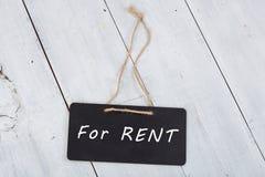 """Lavagne con l'iscrizione """"per affitto """" immagini stock"""