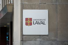 Laval University building and logo. MONTREAL, CANADA - OCTOBER 4, 2018: Laval University building and logo in Montreal. Universite Laval is a French-language royalty free stock photos
