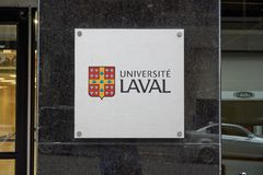 Laval University building and logo. MONTREAL, CANADA - OCTOBER 4, 2018: Laval University building and logo in Montreal. Universite Laval is a French-language stock photography