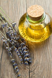 Lavander oil. With flowers on wooden table Royalty Free Stock Images