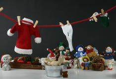 Lavanderia de suspensão de Santa e tomada de um banho Fotografia de Stock