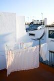 Lavanderia di secchezza nel balcone Fotografia Stock