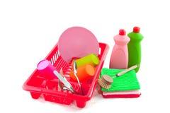 Lavando os pratos do plástico imagem de stock